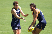 Luke Shuey and Josh Kennedy of the Eagles warm up during a West Coast Eagles AFL training session at Patersons Stadium on February 13, 2014 in Perth, Australia.