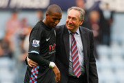 Ashley Young of Aston Villa and Aston Villa manager Gerard Houllier celebrate victory in the Barclays Premier League match between West Ham United and Aston Villa at the Boleyn Ground on April 16, 2011 in London, England.