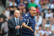 West Ham United manager Avram Grant shouts orders to his team during the Barclays Premier League match between West Ham United and Blackburn Rovers at the Boleyn Ground on May 7, 2011 in London, England.