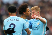Leroy Sane of Manchester City celebrates after scoring his sides first goal with Kyle Walker of Manchester City and Kevin De Bruyne of Manchester City during the Premier League match between West Ham United and Manchester City at London Stadium on April 29, 2018 in London, England.