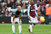 Marko Arnautovic of West Ham United and Patrice Evra of West Ham United look dejected after Manchester City score during the Premier League match between West Ham United and Manchester City at London Stadium on April 29, 2018 in London, England.