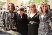"""(L-R) Actor Johnny Depp, musician Natalie Maines of the Dixie Chicks, Producer Lorri Davis and Director/Producer Amy Berg attend the """"West Of Memphis"""" premiere during the 2012 Toronto International Film Festival at Ryerson Theatre on September 8, 2012 in Toronto, Can"""