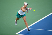 Sabine Lisicki of Germany hits a return during her match against Saisai Zheng of China during the Western & Southern Open at the Lindner Family Tennis Center on August 14, 2016 in Mason, Ohio.