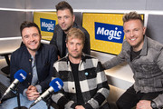 (L-R) Shane Filan, Mark Feehily, Kian Egan and Nicky Byrne of Westlife visit Magic Radio on January 09, 2019 in London, England.