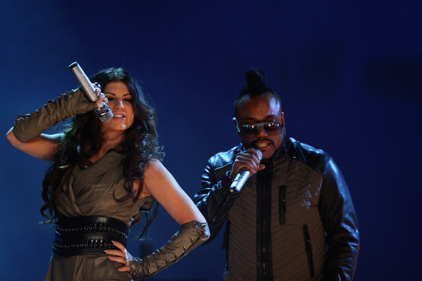 Singer Fergie and apl.de.ap of The Black Eyed Peas performs during the 'Wetten dass...?' show at the Volkswagenhalle on November 7, 2009 in Braunschweig, Germany.