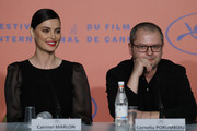 "Catrinel Marlon and Corneliu Porumboiu attend the ""The Whistlers (La Gomera/ Les Siffleurs)"" press conference during the 72nd annual Cannes Film Festival on May 19, 2019 in Cannes, France."