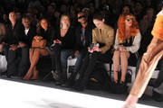 (L-R) Photographer Nigel Barker, model Tyson Beckford, TV peronality Angela Simmons, actress Allie Gonino, actor Eric West, model Coco Rocha, and musician Neon Hitch attend the Whitney Eve Fall 2012 fashion show during Mercedes-Benz Fashion Week at The Studio at Lincoln Center on February 15, 2012 in New York City.