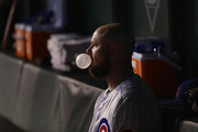 Jon Lester #34 of the Chicago Cubs blows a bubble as he sits in the dugout during the National League Wild Card Game against the Colorado Rockies at Wrigley Field on October 2, 2018 in Chicago, Illinois.
