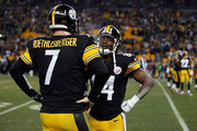 Ben Roethlisberger #7 speaks with Antonio Brown #84 of the Pittsburgh Steelers on the bench in the fourth quarter against the Baltimore Ravens during their AFC Wild Card game at Heinz Field on January 3, 2015 in Pittsburgh, Pennsylvania.
