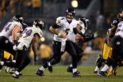 Joe Flacco #5 of the Baltimore Ravens drops back against the Pittsburgh Steelers during their AFC Wild Card game at Heinz Field on January 3, 2015 in Pittsburgh, Pennsylvania.