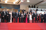 "(L-R) Actor Akin Aksu, a guest, producer Zeynep Ozbatur Atakan, actress Hazar Erguclu, actor Dogu Demirkol, director Nuri Bilge Ceylan, Ayaz Ceylan, writer Ebru Ceylan, actor Murat Cemcir, actress Bennu Yildirimlar, actress Ozay Fecht, actress Asena Keskinci, actor Ahmet Rifat Sungar, actor Oner Erkan and festival director Thierry Fremaux attend the screening of ""The Wild Pear Tree (Ahlat Agaci)"" during the 71st annual Cannes Film Festival at Palais des Festivals on May 18, 2018 in Cannes, France."