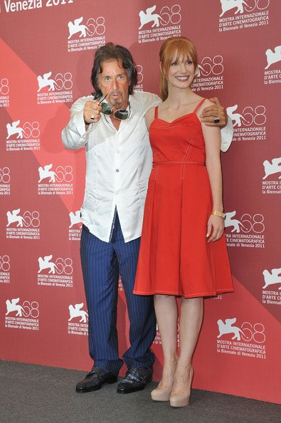 "Director/actor Al Pacino (L) and actress Jessica Chastain pose at the ""Wild Salome"" photocall during the 68th Venice Film Festival at Palazzo del Cinema on September 4, 2011 in Venice, Italy."