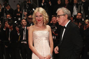 """Actress Naomi Campbell and Director Woody Allen depart the """"You Will Meet A Tall Dark Stranger"""" Premiere at the Palais des Festivals during the 63rd Annual Cannes Film Festival on May 15, 2010 in Cannes, France."""