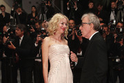 """Actress Naomi Watts and Director Woody Allen depart the """"You Will Meet A Tall Dark Stranger"""" Premiere at the Palais des Festivals during the 63rd Annual Cannes Film Festival on May 15, 2010 in Cannes, France."""