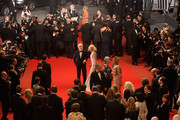 """Naomi Watts and Woody Allen leave the """"You Will Meet A Tall Dark Stranger"""" Premiere at the Palais des Festivals during the 63rd Annual Cannes Film Festival on May 15, 2010 in Cannes, France."""