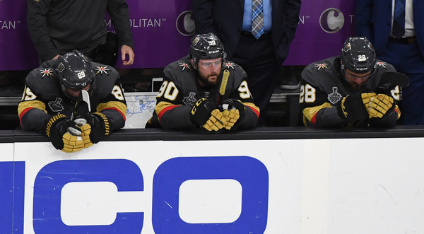 2018 NHL Stanley Cup Final - Game Five [sports gear,ice hockey,sports,college ice hockey,player,jersey,team sport,ice hockey equipment,hockey,stick and ball games,tomas tatar 90,alex tuch 89,five,l-r,bench,nhl,washington capitals,vegas golden knights,stanley cup final,win]