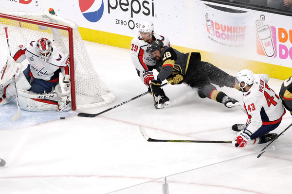 2018 NHL Stanley Cup Final - Game Five [ice hockey,ice hockey position,sports,hockey protective equipment,college ice hockey,player,sports gear,hockey,team sport,bandy,william carrier,christian djoos,braden holtby,five,shot,t-mobile arena,nhl,vegas golden knights,washington capitals,stanley cup final]