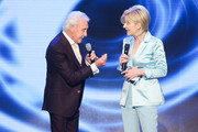 (L-R) Tony Christie and Carmen Nebel perform on stage during the tv show 'Willkommen bei Carmen Nebel' at Tempodrom on April 7, 2016 in Berlin, Germany.