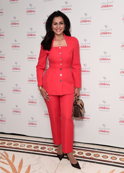 Caudwell Children London Ladies Lunch - Arrivals [clothing,red,pantsuit,suit,fashion,formal wear,outerwear,fashion design,red carpet,style,caudwell children london ladies lunch,wilnelia forsyth,london,england,the dorchester,arrivals]