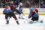 A shot by Joel Armia #40 of the Winnipeg Jets goes wide of goaltender Semyon Varlamov #1 of the Colorado Avalanche at the Pepsi Center on January 2, 2018 in Denver, Colorado.