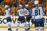 Josh Morrissey #44, Mark Scheifele #55, Blake Wheeler #26, and Kyle Connor #81 celebrate a goal against the Nashville Predators during the second period in Game Seven of the Western Conference Second Round during the 2018 NHL Stanley Cup Playoffs at Bridgestone Arena on May 10, 2018 in Nashville, Tennessee.