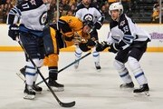 Michael Del Zotto #5 of the Nashville Predators is sandwhiched between James Wright #17 and Tobias Enstrom #39 of the Winnipeg Jets at Bridgestone Arena on March 1, 2014 in Nashville, Tennessee.