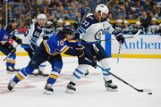 Brayden Schenn #10 of the St. Louis Blues battles Dustin Byfuglien #33 of the Winnipeg Jets for control of the puck at the Enterprise Center on October 4, 2018 in St. Louis, Missouri.