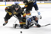 William Karlsson #71 of the Vegas Golden Knights and Paul Stastny #25 of the Winnipeg Jets battle for the puck during the third period in Game Four of the Western Conference Finals during the 2018 NHL Stanley Cup Playoffs at T-Mobile Arena on May 18, 2018 in Las Vegas, Nevada. The Golden Knights defeated the Jets 3-2.