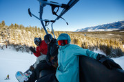 (L-R) Mountain Dew Snowboarders Danny Davis, Julia Marino and Red Gerard ride the lift together during first tracks at Dew Tour at Breckenridge Ski Resort on December 14, 2018 in Breckenridge, Colorado.