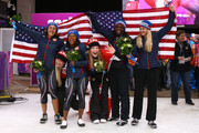 Gold medallists Kaillie Humphries (2ndL) and Heather Moyse (3rdR) of Canada team 1 pose with silver medallists Elana Meyers (L) and Lauryn Williams (3rdL) of the United States team 1 and bronze medallists Jamie Greubel (R) and Aja Evans (2ndR) of the United States team 2 during the flower ceremony during the Women's Bobsleigh on Day 12 of the Sochi 2014 Winter Olympics at Sliding Center Sanki on February 19, 2014 in Sochi, Russia.