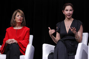 Actress and activist Ashley Judd (R) speaks as U.S. Rep. Jackie Speier (D-CA) looks on during the 29th annual Conference of the Professional Businesswomen of California (PBWC) on April 24, 2018 in San Francisco, California. The PBWC is a day of keynote speakers and seminars by top female leaders and panels of industry experts.