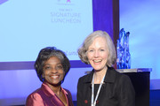 Acting Chairwoman of the Federal Communications Commission Mignon Clyburn (L) and Amy Tykerson pose for a photo during the 2013 Women in Cable Telecommunications Signature Luncheon at Walter E. Washington Convention Center on June 10, 2013 in Washington, DC.