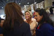 """Rep. Ileana Ros-Lehtinen (R-FL) greets people during the Women for Mitt kick-off of a  """"Stronger Middle Class"""" Bus Tour of South Florida on September 17, 2012 in Miami, Florida.  The bus tour is scheduled to stop at events at women-owned businesses in Miami, Ft. Lauderdale, and Boca Raton as the Romney campaign tries to gather more support from women."""
