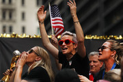 Ali Krieger, Megan Rapinoe, and Ashlyn Harris celebrate while riding on a float during the U.S. Women's National Soccer Team Victory Parade through the Canyon of Heroes on July 10, 2019 in New York City. The team defeated the Netherlands 2-0 Sunday in France to win the 2019 Women's World Cup.