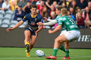 Ryan Mills of Worcester Warriors kicks the ball past Toby Flood and Chris Harris of Newcastle Falcons during the Gallagher Premiership Rugby match between Worcester Warriors and Newcastle Falcons at Sixways Stadium on September 15, 2018 in Worcester, United Kingdom.