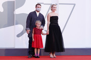 """Director Mona Fastvold, Adelaide James Fastvold Corbet and Brady Corbet  walk the red carpet ahead of the movie """"The World To Come"""" at the 77th Venice Film Festival on September 06, 2020 in Venice, Italy."""