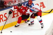 John Tavares #20 of Team Canada battles for the puck with Andrei Markov #79 of Team Russia during the third period at the semifinal game during the World Cup of Hockey tournament at Air Canada Centre on September 24, 2016 in Toronto, Canada. Team Canada defeated Team Russia 5-2.
