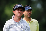 Gonzalo Fernandez - Castano and Alvaro Quiros of Spain during a practice round of the World Golf Championship Bridgestone Invitational on August 4, 2009 at Firestone Country Club in Akron, Ohio.