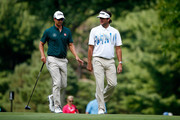 Adam Scott of Australia (L) and Bubba Watson speak on the 11th fairway during the first round of the World Golf Championships-Bridgestone Invitational at Firestone Country Club South Course on July 31, 2014 in Akron, Ohio.