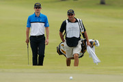 Justin Rose of England walks to the first green with his caddie Mark Fulcher during the third round of the World Golf Championships-Cadillac Championship at the Trump Doral Golf Resort & Spa on March 9, 2013 in Doral, Florida.