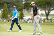 (R-L) Marc Leishman of Australia picks up his ball as Gary Woodland lines up a putt on the 16th hole during round four of the World Golf Championships Cadillac Match Play at TPC Harding Park on May 2, 2015 in San Francisco, California.