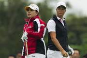 Inbee Park (L) of South Korea and Suzann Pettersen of Norway wait to play on the 7th tee during the Round 4 of the World Ladies Championship at Mission Hills' Blackstone Course on March 9, 2014 in Hainan Island, China.