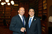 In this handout photo provided by the G20 Australia, Australia's Prime Minister Tony Abbott greets Japan's Prime Minister Shinzo Abe in the Reading Room at Parliament House during the G20 Leaders' Summit on November 15, 2014 in Brisbane, Australia. World leaders have gathered in Brisbane for the annual G20 Summit and are expected to discuss economic growth, free trade and climate change as well as pressing issues including the situation in Ukraine and the Ebola crisis.
