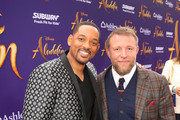 "Will Smith (L) and Director Guy Ritchie attend the World Premiere of Disney?s ""Aladdin"" at the El Capitan Theater in Hollywood CA on May 21, 2019, in the culmination of the film?s Magic Carpet World Tour with stops in Paris, London, Berlin, Tokyo, Mexico City and Amman, Jordan."