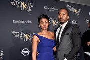 Actor Emayatzy Corinealdi (L) and Jermaine Oliver arrive at the world premiere of Disney's 'A Wrinkle in Time' at the El Capitan Theatre in Hollywood CA, March 26, 2018.