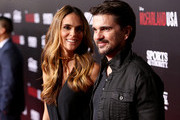 """Musician Juanes (R) and Karen Martinez attend the world premiere of """"McFarland, USA"""" at The El Capitan Theatre on February 9, 2015 in Hollywood, California."""