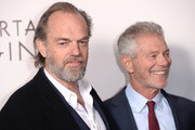 """Hugo Weaving (L) and Stephen Lang attend the World Premiere of """"Mortal Engines"""" at Cineworld Leicester Square on November 27, 2018 in London, England."""