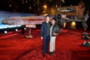"Actors Harry Shum Jr. (L) and Shelby Rabara attends The World Premiere of Lucasfilm's highly anticipated, first-ever, standalone Star Wars adventure, ""Rogue One: A Star Wars Story"" at the Pantages Theatre on December 10, 2016 in Hollywood, California."