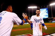 Eric Hosmer #35 of the Kansas City Royals celebrates with Salvador Perez #13 of the Kansas City Royals after defeating the New York Mets 5-4 in Game One of the 2015 World Series at Kauffman Stadium on October 27, 2015 in Kansas City, Missouri.