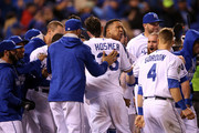 Eric Hosmer #35 of the Kansas City Royals and Salvador Perez #13 of the Kansas City Royals celebrate defeating the New York Mets 5-4 in Game One of the 2015 World Series at Kauffman Stadium on October 27, 2015 in Kansas City, Missouri.